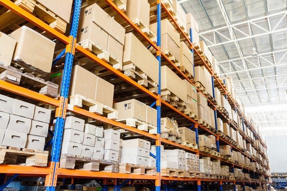 Boxes stored on racks in a warehouse.
