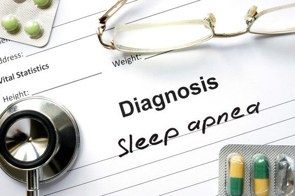 A written diagnosis of sleep apnea next to a stethoscope.