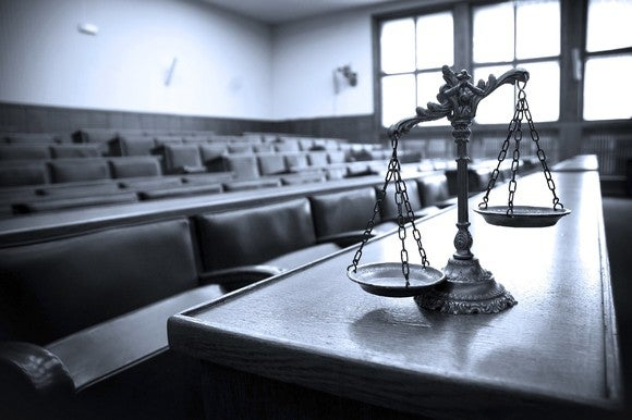 Justice scales in courtroom