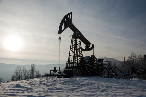 Oil pump in the winter snow.