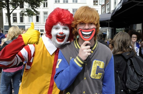 McDonald's celebrates redheads in the Netherlands in 2013 as Ronald McDonald poses with a customer.