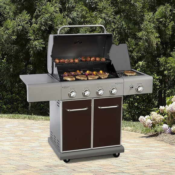 A Kenmore gas grill on a patio.