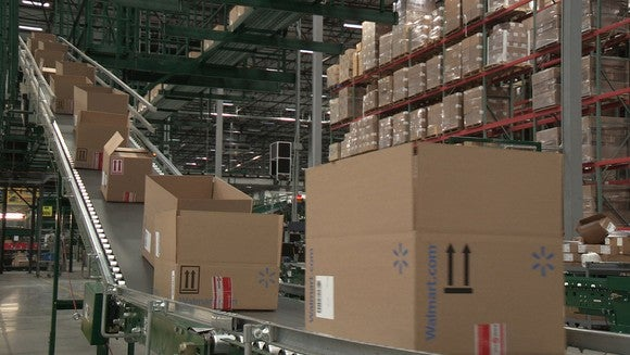 Cardboard Wal-Mart boxes on a sloped conveyer belt in Wal-Mart fulfillment center