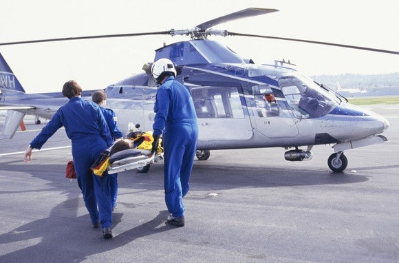 Medics loading patient into helicopter