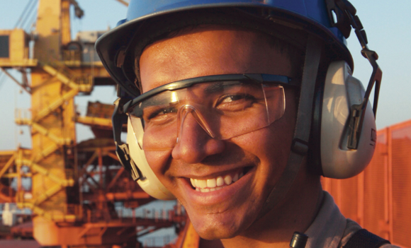 A picture of an Alcoa employee smiling.