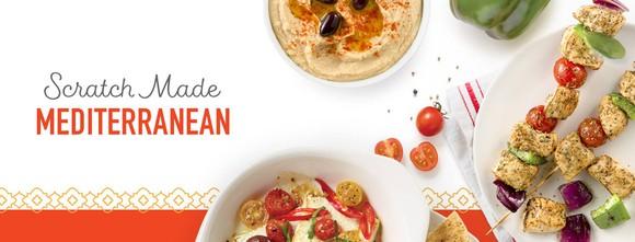 A platter of Zoe's Kitchen Mediterranean food.