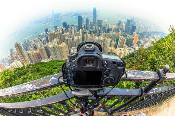 A view of Hong Kong from behind a camera perched high in the sky.