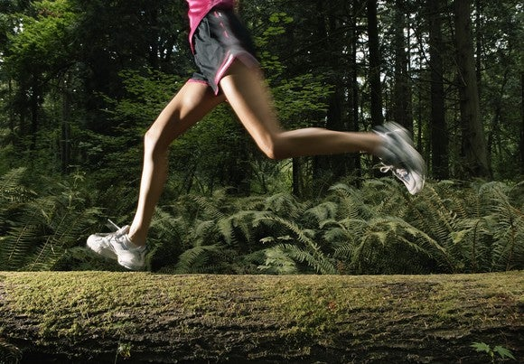 A jogger running through the forest.