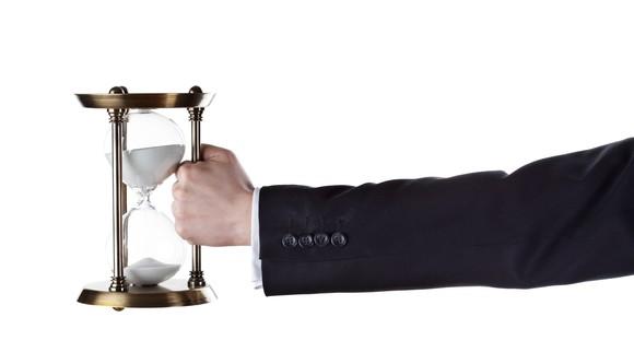 hand holding hourglass