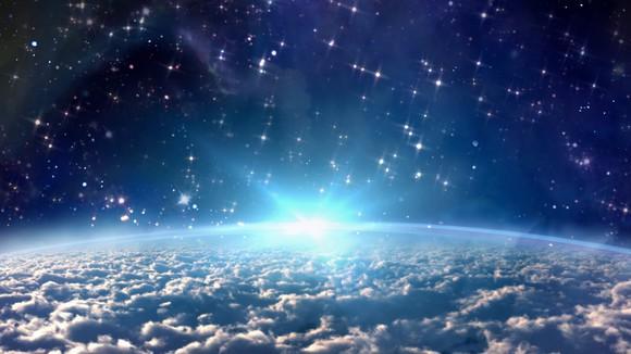 Bright star rising above horizon.