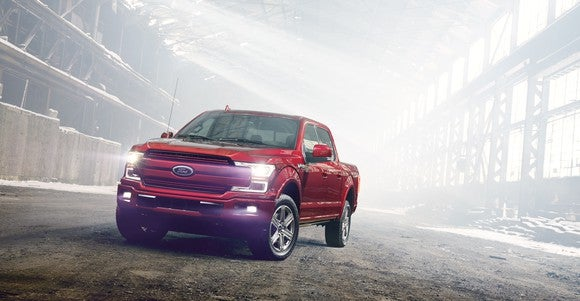A red 2018 Ford F-150 pickup.