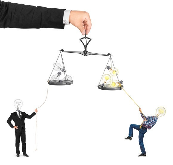Two people with light bulbs for heads pulling on two sides of a balance scale.