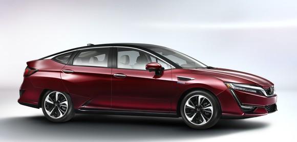 A red Honda Clarity Fuel Cell sedan.