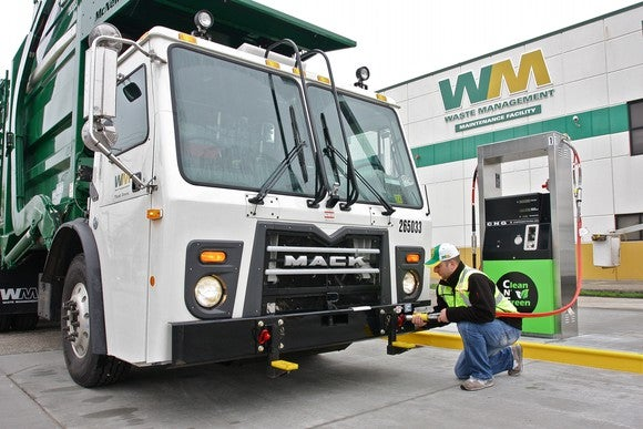 A Waste Management truck at a maintenance facility.