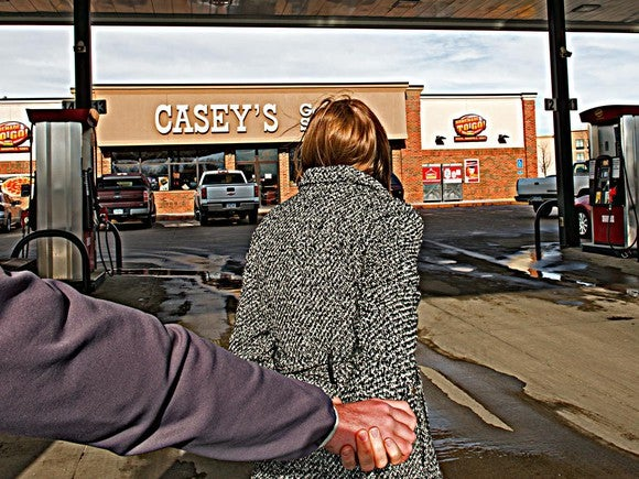 Man and woman walking towards a Casey's General Store