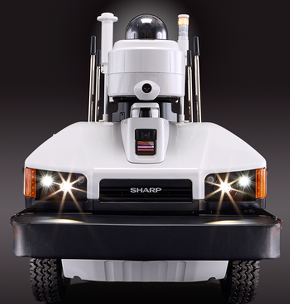 A Sharp Intellios A-UGV drone, which has a security camera mounted to the top of a small truck.
