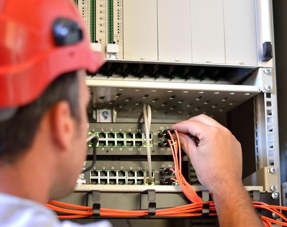 Technician hooking up cable fiber