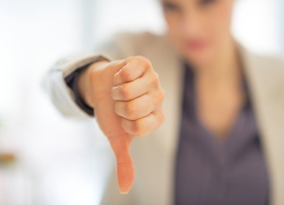 A woman giving a thumbs down.