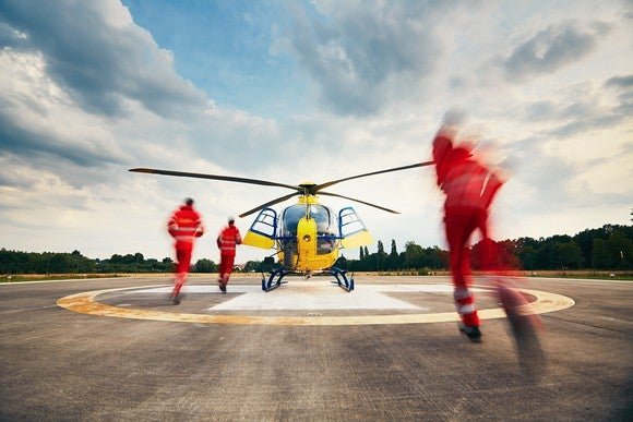 Crew rushing to medevac helicopter.