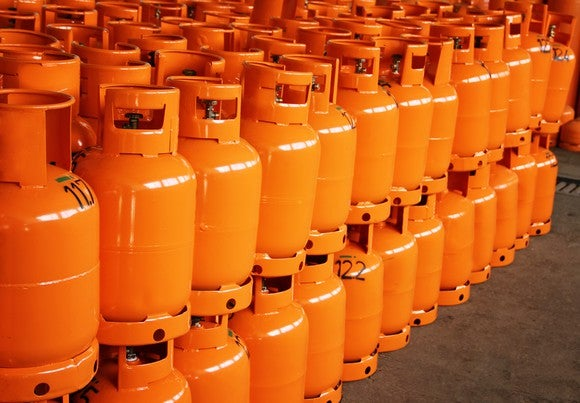 individual stacked orange propane tanks