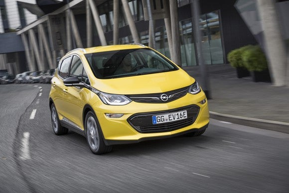 A yellow Opel Ampera-e crossover.