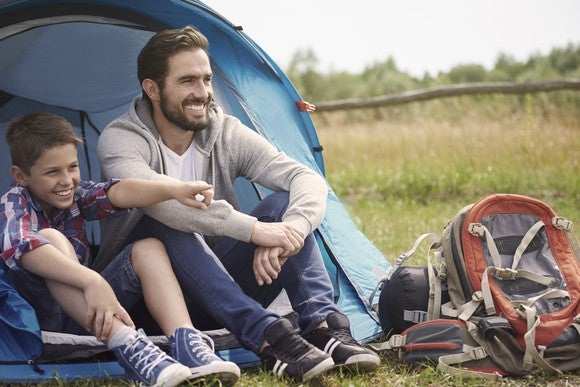 Father and son camping in the outdoors