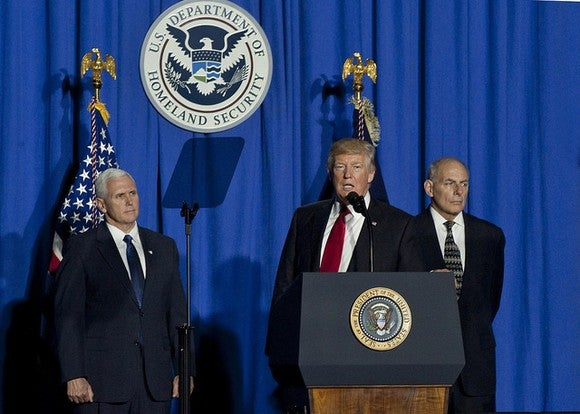 Donald Trump flanked by VP Mike Pence and DHS Secretary John Kelly.