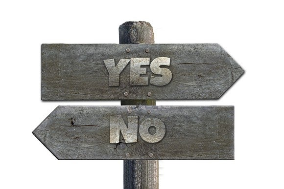 Signs at intersection, one says yes, one says no