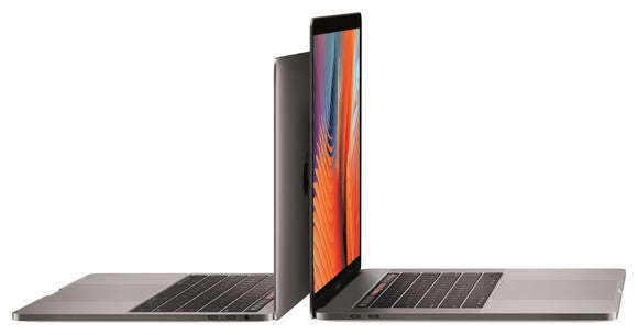 This image shows Apple's 13-inch and 15-inch MacBook Pro computers aligned back-to-back with each other.