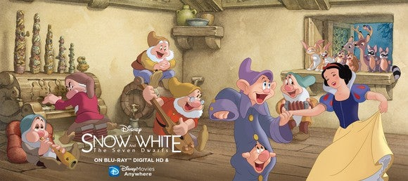 An advertisement for Disney's Classic Snow White film showing Snow White surrounded by the seven dwarves.