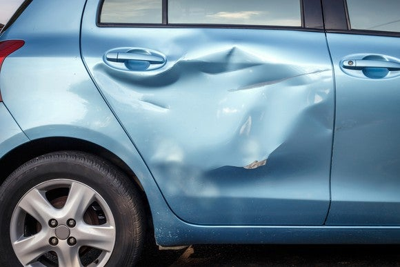 Picture of the dented side of a car.