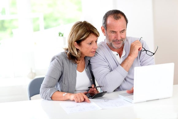 Couple looking at a laptop, planning for retirement.