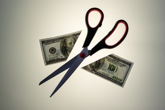 scissors cutting bill in half