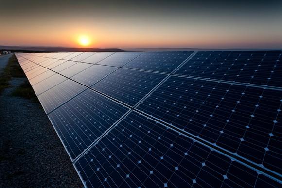 A solar farm at dusk.