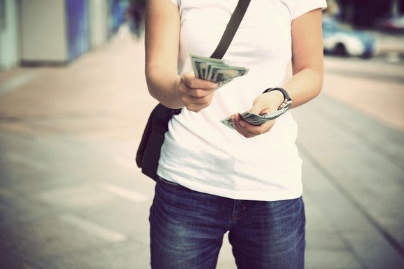 Lady handing out cash