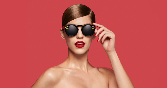 Woman on red background wearing Snap Spectacles