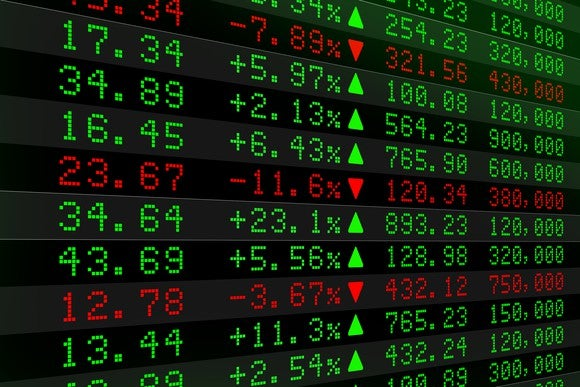 Stock tickers showing rising and falling prices.