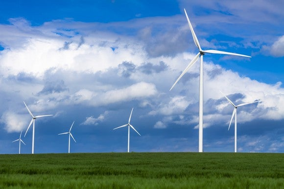 Wind turbines in a green field.