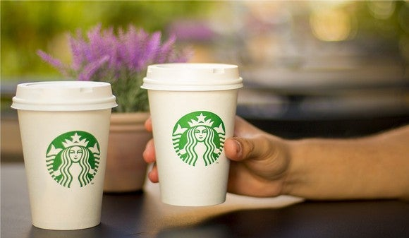 Two Starbucks paper cups