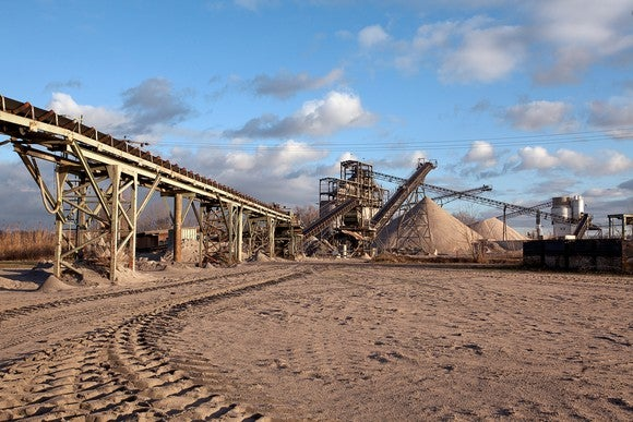 Sand pit with mining equipment