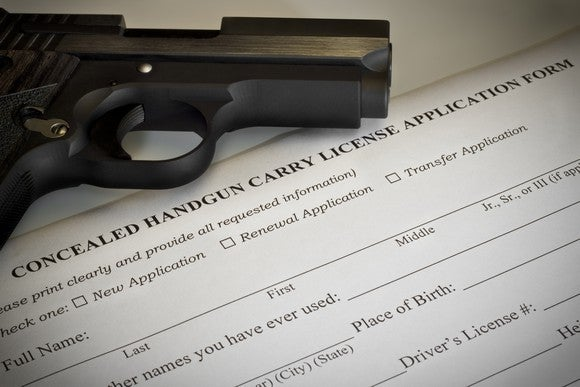 Pistol laying on a concealed carry permit application