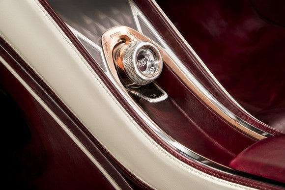 """A close-up of the glass """"Start"""" button in the Bentley EXP 12 Speed 6e Concept."""