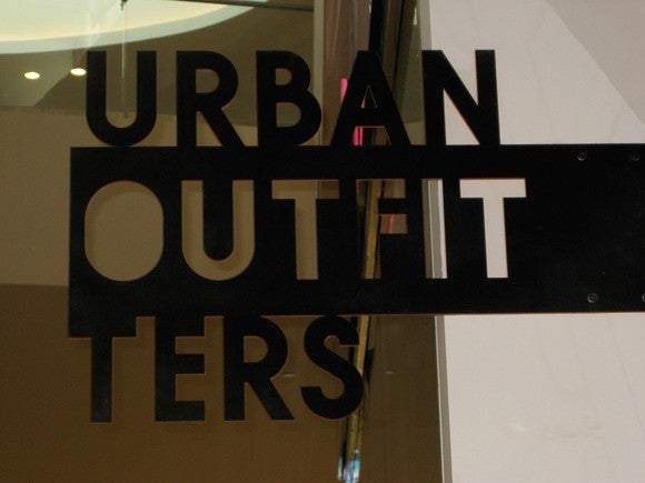 A sign on the window of an Urban Outfitters store
