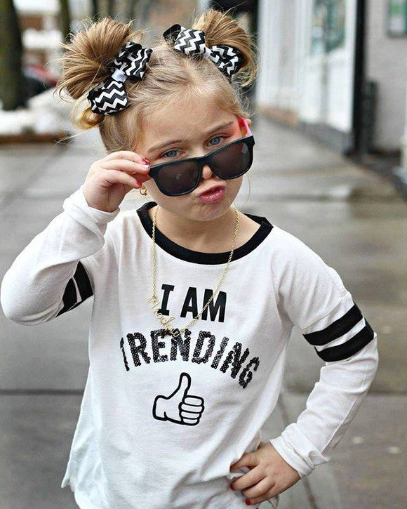 A child decked out in apparel from The Children's Place.