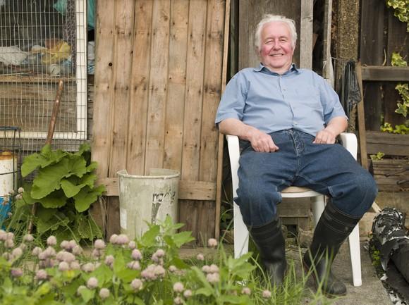Senior man sitting in a garden