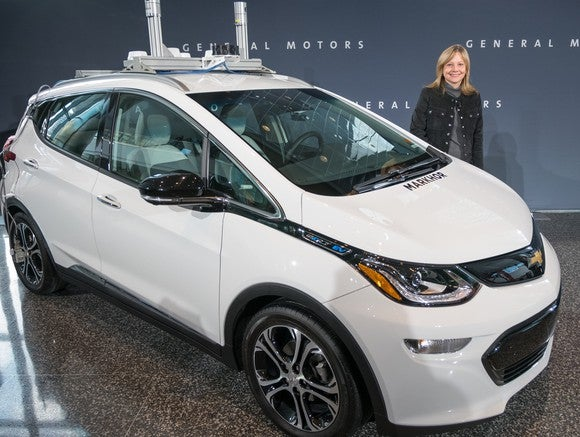 A white Chevy Bolt in a showroom.