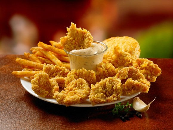 Restaurant Brands International is diversifying its menu by acquiring Popeye's Louisiana Chicken and its Dip'n Chick'n dish