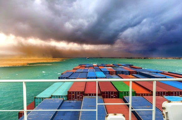 Containers on a ship heading into a storm