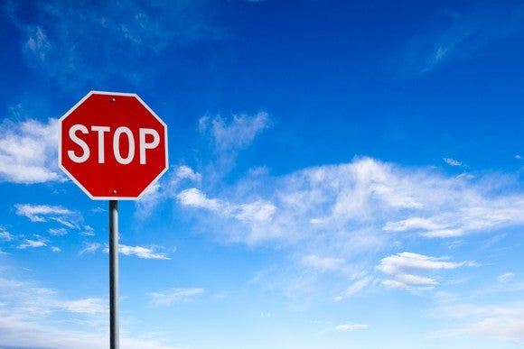 Picture of stop sign with sky in the background.