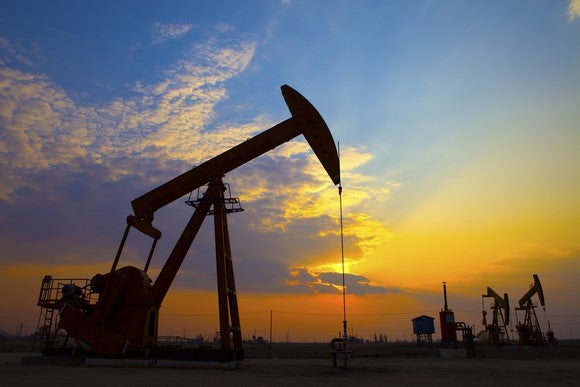 An oil pump at sunset